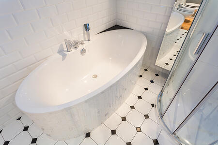 Close-up of porcelain bath in luxury apartment